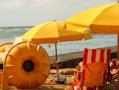 Yellow beach umbrellas in Hawaii