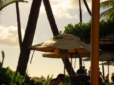Beige umbrella by the beach