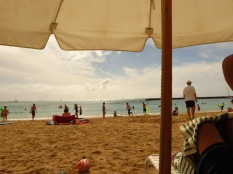 Under a white umbrella in Hawaii