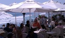 White beach umbrellas in Laguna Beach
